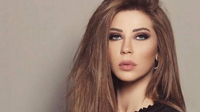 """الإعلامية اللبنانية الحسناء """"كارلا حداد"""" تثير متابيعها بصورة رياضية """"ساخنة""""..! (شاهد)"""